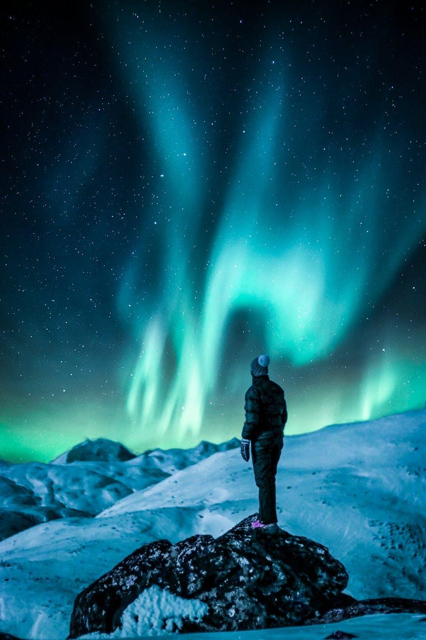 man standing near snow field