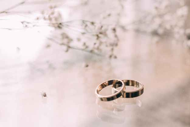 two silver colored rings on beige surface