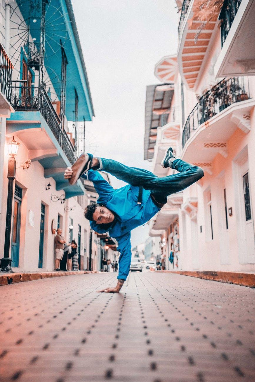 man break dancing on street