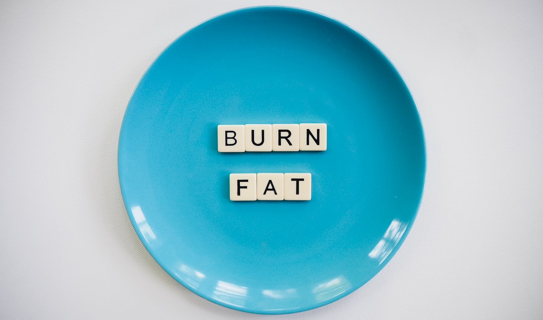 photo of a burn fat text on round blue plate